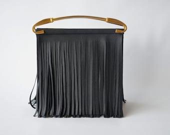 Fringe in semi leather portfolio
