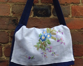 Vintage embroidery on a messenger style bag