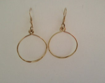 "14k Goldfilled  medium sized dangle hoop earrings.  These earrings are 2"" long from curve of the earwires and 1.25"" wide."