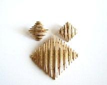 signed Crown Trifari brooch and earring set . demi parure Trifari jewelry . Trifari earrings  gold tone . vintage designer jewelry