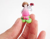 Tiny paper fairy with ladybug in pink. Miniature Quilling.