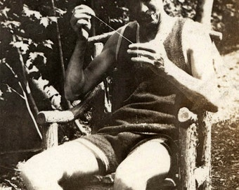 vintage photo 1915 Man Sits in Swimsuit Sewing Needle and Thread