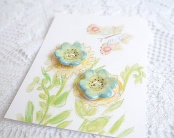 2 Flower Buttons in Porcelain Ceramic Clay, Painted Blue Brown Green and Yellow