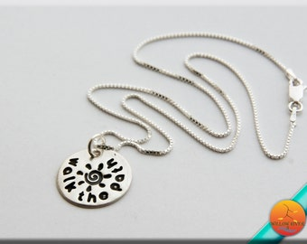 Walk The Path Silver Necklace featuring a handmade fine silver sun charm with celtic spiral on a sterling silver chain