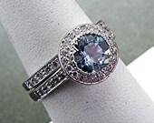 AAAA Blue Aquamarine   7.00mm  1.18 Carats   14K white gold diamond halo bridal set. B007 0338