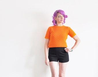 mod neon orange red sweater top . short sleeve polka dot pattern knit .small.medium .sale