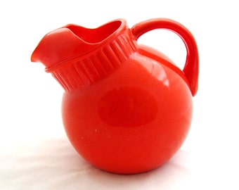 Vintage Tilted Ball Juice Pitcher -1940's BRIGHT ORANGE Paint Glass Anchor Hocking