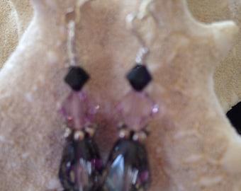 Swarovski dangle earrings in pink,purple.