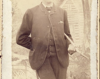 Well Dressed Man Holding CANE Under His Arm with Other Arm TUCKED Behind His BACK Cabinet Photo Circa 1890s