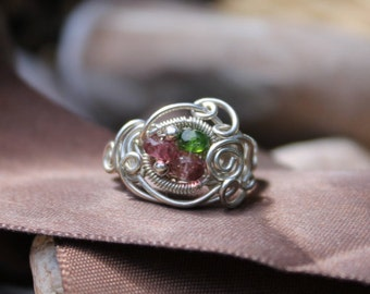 Spiral wire wrapped sterling silver ring, with pink and grass green tourmaline.