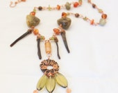 Autumn Stone Necklace with spirals rusted washer large garnets and lip shell talons - Half Wished - orange agate green peridot brown wood