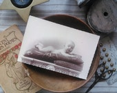 Antique french card photography little baby on cushions 1920s