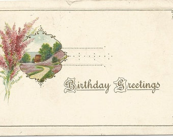 """Heather Bouquet next to framed picture of a meadow scene with cottage """"Birthday Greetings"""" Vintage Postcard"""