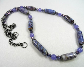 "Swirls of Purple Tube Shaped Lampwork Beaded Necklace in Gunmetal - 24"" Length with Extender"