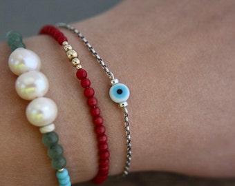Sterling silver evil eye bracelet.