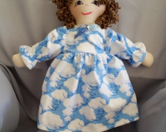 Old fashioned15 inch cloth doll with brown hair and blue nightgown from the Ann Marie Collection