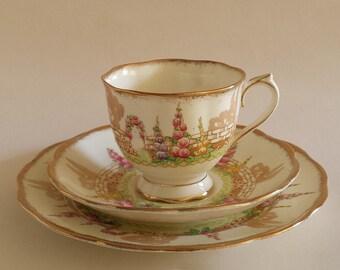 English Vintage Royal Albert china set: cup, saucer and cake plate 1935/40
