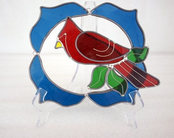 Male cardinal sun catcher , blue boarder , green leaves, large, vintage