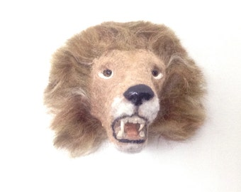 Lion head with mane and teeth-- also a magnet