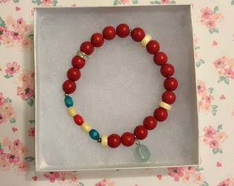 Beautiful spring/summer lucky charm stretchy bracelet. Great for everyday wear and perfect birthday gift.