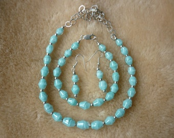 Turquoise handblown 3 peice boro glass jewelry set.