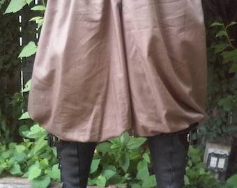 "Rus Pants. Drawstring waist fits up to 54"" waist."