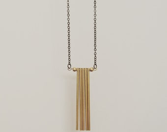 Brass fringe pendant on a gunmetal chain