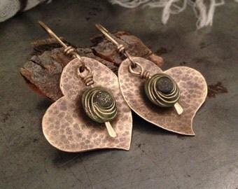 Antique brass earrings with green spiral beads on heart earrings