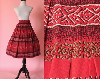 Wisco of London skirt/ 1950s novelty print skirt/ 50s red swing skirt/ tribal print/ small • free US shipping