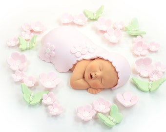 Baby Girl Sugar Paste Cake Topper with Pale Pink Blanket, Flowers & Green Butterflies for Baby Shower by lil sculpture