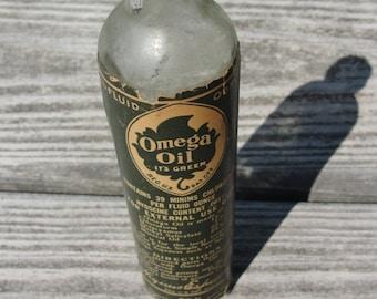 Vintage Omega Oil bottle 1940s