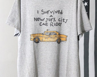 "Faded Soft Grey 90s ""I Survived A New York City Cab Ride"" T-Shirt"