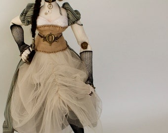 Evangeline is an exquisite Steampunk cloth art doll crafted from elegant upcycled materials, her character exuding strength and compassion.