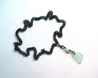 Light Blue Sea Glass with a Light Jade bead held with an Enameled Lobster Clasp on a Thick Shiny Black Curb Chain with a Lobster Clasp