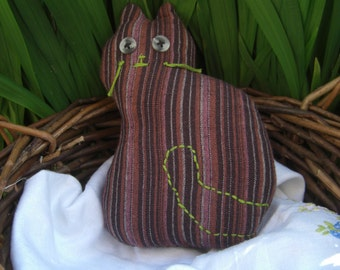 Soft toy cat in stripey brown.
