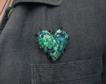 Heart brooch in green and blue.