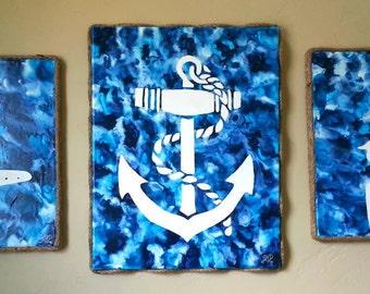 Three piece nautical crayon art.