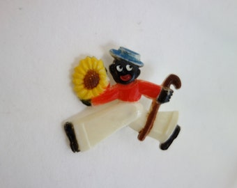 80's lapel pin, ethnic image, a Golliwog.