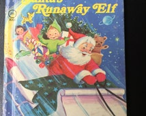 Santa's Runaway Elf Hardcover – 1977 by Jean Lewis (Author), Marjorie Cooper (Illustrator)