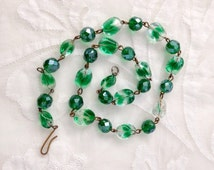 1950s Green Glass Bead Necklace. Metal strung Clear and green glass beads.
