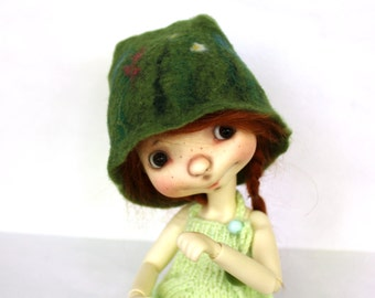 Felted green cap for Sprocket by Connie Lowe, and dolls similar format