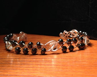 Silver braided cuff bracelet; Gunmetal Miyuke glass beads