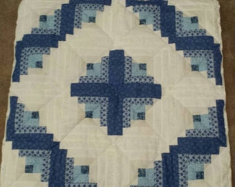 Log cabin quilted table topper- white and blue
