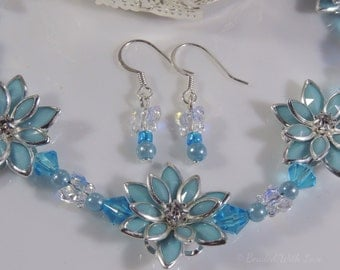 Blue diamonte flower and Swarovski crystal butterfly necklace and earring set