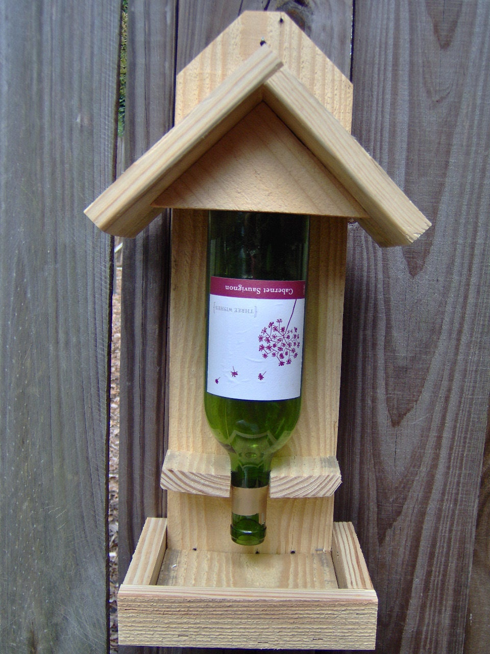 Build your own bird feeders 4 easy ways to make a bird for Plastic bottle bird house