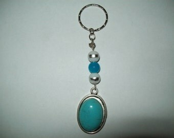 Blue beaded keyring with blue oval shaped cameo style pedant