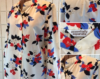 Adorable floral polyester blouse, size small