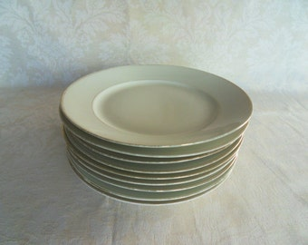 Nine classic white Limoges porcelain plates by Betoule and Legrand
