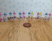 Dolls house 2 x filled baby bottle of milk with 6 characters to choose from 112 scale