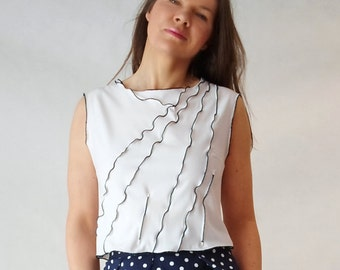 white top with navy blue seam